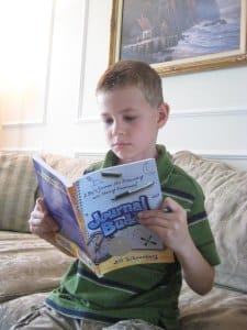 3rd Grade Boy with  Journal Buddies