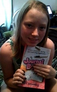 Happy Girl with Copy of Journal Buddies