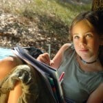 Girl Journal Writing Outside