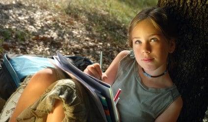 Girl Journal Writing Outside