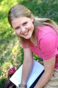 Smiling< Happy Girl Journaling