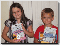 girl and boy with Journal Buddies